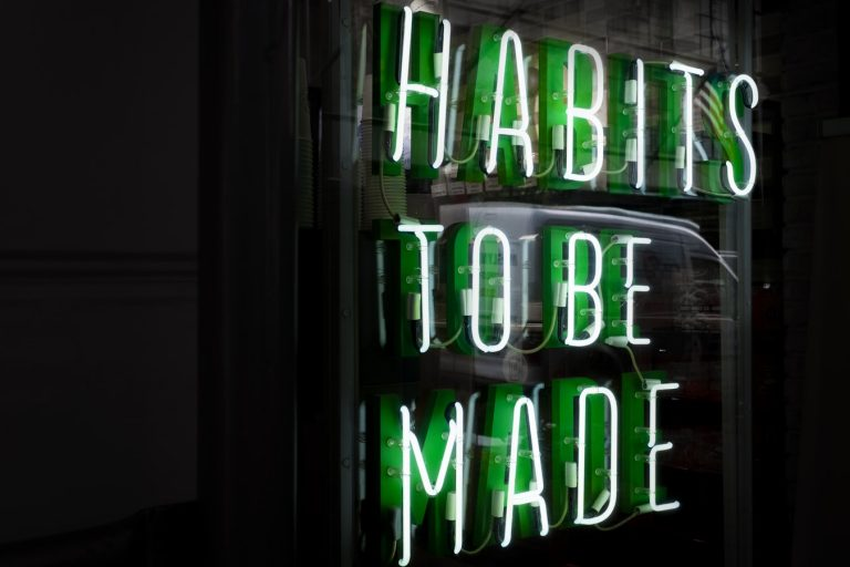 habits to be made green neon sign with black background